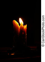 View of a melted candle on low light conditions.