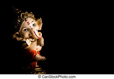 low light photography of beautiful ganesha statue on black background. worship concept