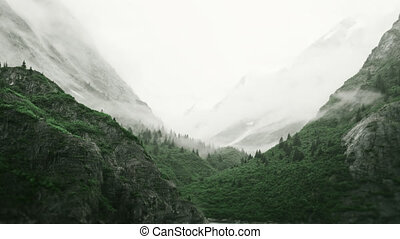 Low Lying Clouds Shroud The Mountain Tops In Misty Fjords National Monument, Southeast Alaska, USA