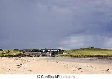 Low Newton by the Sea with heavy clouds