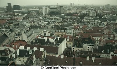 Low-rise roofs of Vienna on a hazy day, Austria. 4K overview...