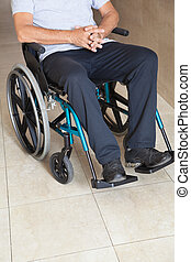 Low Section Of a Senior Man Sitting In a Wheelchair