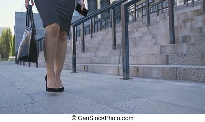 Low section of business woman walking to job - Low section...