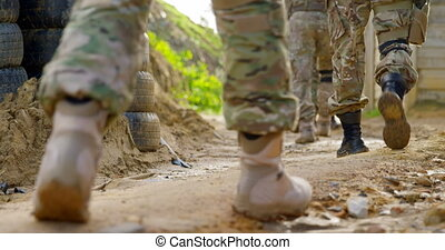 Low section of military soldiers walking during military ...