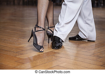 Low Section Of Tango Dancers Performing Parallel Walk - Low...