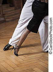 Low Section Of Tango Dancers Performing On Hardwood Floor