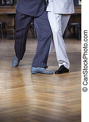 Low Section Of Tango Partners Performing Scissors Step