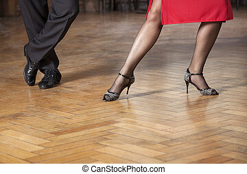 Low Section Of Tango Professionals Performing In Cafe