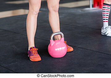 Low Section Of Woman With Pink Kettlebell