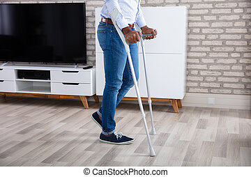 Disabled Man Walking With Crutches