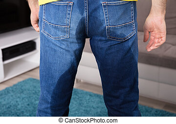 Low Section View Of Person's Wet Jeans