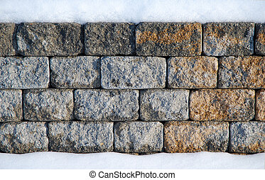 Low stone wall - snow on the bottom and on top