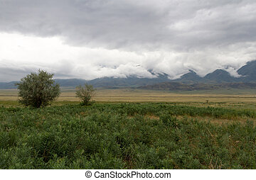 low storm clouds in the mountains