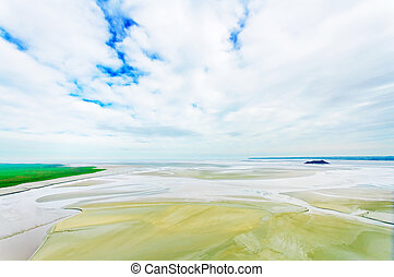 Low tide landscape in Mont Saint Michel Bay. Normandy, France.