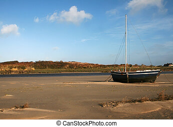 Low tide - Lonely boat at low tide.