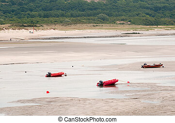 low tide - Low tide at the beach with rubber boats