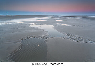low tide on North sea and sunrise, Schiermonnikoog, Holland
