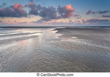 low tide on North sea during sunrise