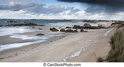 Low tide - Sandy and rocky coastline in France in low tide,...