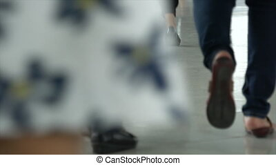 Low View of peoples walking, Shallow Depth Of Field.