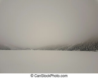 Low visibility conditions due to a fog in Tatry in Poland at winter time