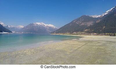 """""""Low water level in lake for energy saving during off-season at Alpine ski resort"""""""