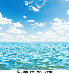 low white clouds over blue sea