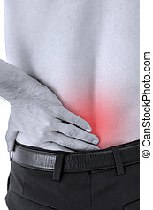 Lower back pain - Closeup of man with lower back pain.