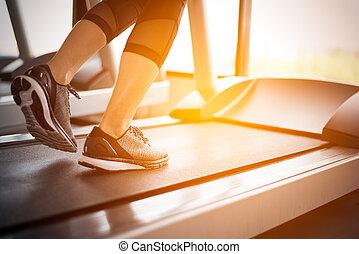 Lower body at legs part of Fitness girl running on running ...