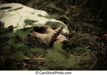 Lower body of abandoned murder victim in dark countryside...