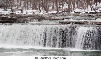 Thirty second loop features Indiana's Lower Cataract Falls with a snowy landscape.
