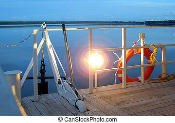 lower deck - anchor, lamp and life buoy on a lower deck...