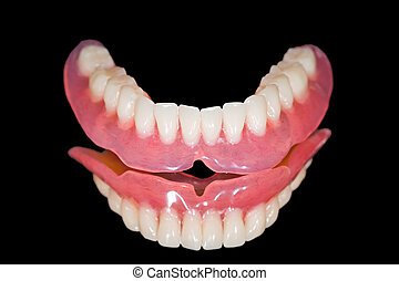 Lower denture - Artificial lower denture on isolated black ...