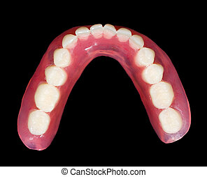 Lower denture - Artificial lower denture on isolated black...