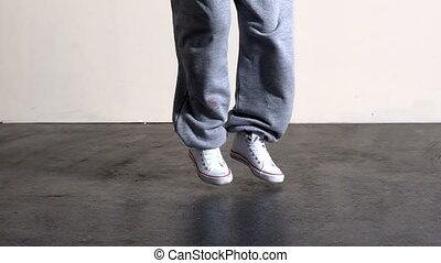 Lower half of sporty dancers feet