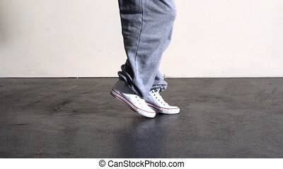 Lower half of sporty dancers feet m