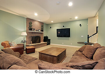 Lower level basement with stone fireplace and large screen ...