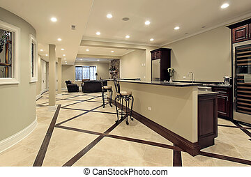 Lower level with bar area - Lower level in luxury home with ...