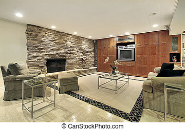 Lower level with stone fireplace - Lower level family room...