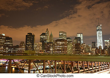 Lower Manhattan from Brooklyn bridge in New York City at night