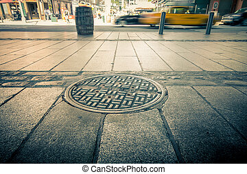 Lower Manhattan - Manhole drain cover on streets of lower...