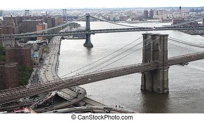 lower manhattan skyline and brooklyn bridge from a high vantage point