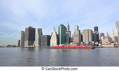 Lower Manhattan skyline and cargo ship in New York City
