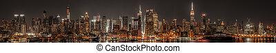 Lower Manhattan skyline at night panoramic view