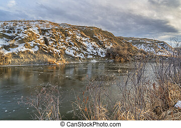 lower Poudre River between Windor and Greeley in northern Colorado, winter scenery with snow and ice