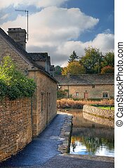 The mill race at Lower Slaughter near Bourton on the Water, Gloucestershire, England.