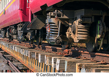 lower view of trainst suspension on old wood railways bridge