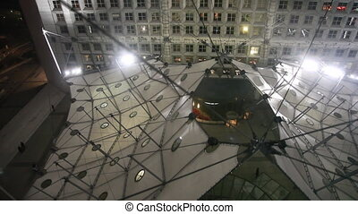 Lowered down into glass elevator at Grand Arch of La Defense in Paris