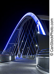 Lowry Avenue or County Highway 153 bridge deck and walkway illuminated at night in northeast Minneapolis Minnesota