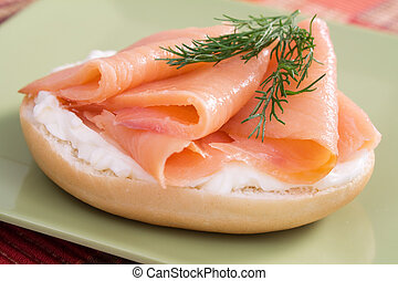 Lox and Cream Cheese Bagel - Bagel topped with cream cheese,...